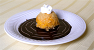 plated fried ice cream with fancy syrup